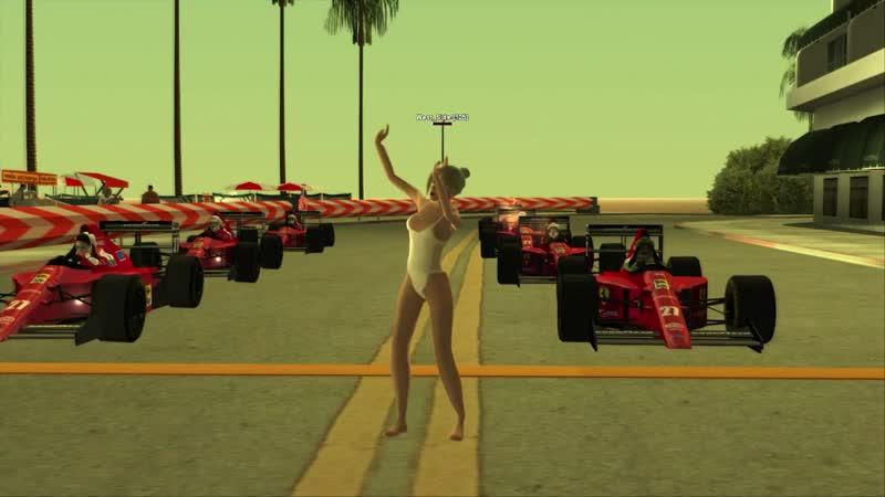 GIRL FLEX ON BEACH WITH F1 CAR