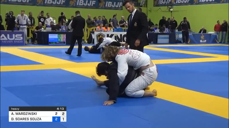 Adam Wardzinski Uses His Trademark Butterfly Sweep To Secure A Choke