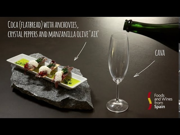 Spanish tapas recipes Coca flatbread with anchovies crystal peppers and Manzanilla olive air