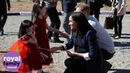 Meghan, The Duchess of Sussex, shows off her new henna tattoo to cute little girls