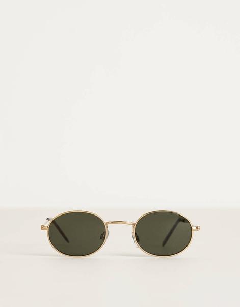 Солнечные очки овальной формы